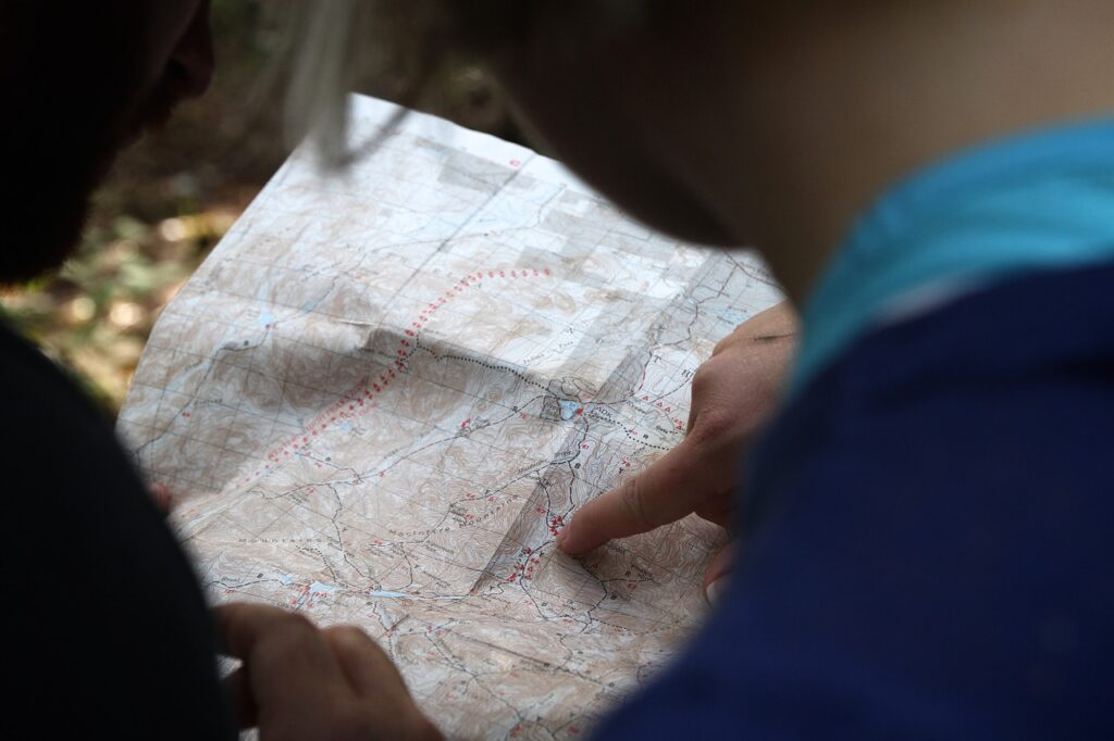 Two people look at a map.
