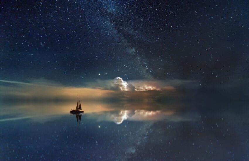 A ship sailing in the night sky.